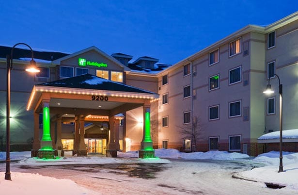 Holiday Inn Elk River - exterior at night.